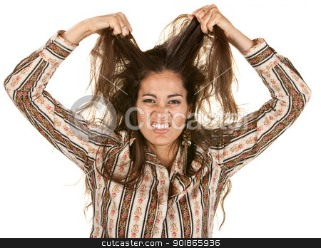 Upset Woman Pulling Hair stock photo, Disgusted Latina pulling on strands of hair by Scott Griessel
