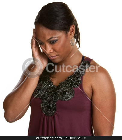 Black Woman Holding Head stock photo, Black woman with hand on head looking down by Scott Griessel