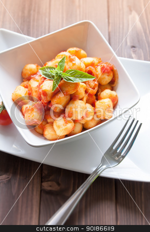 Gnocchi al pomodoro stock photo, homemade gnocchi with tomato sauce basil and onions by Giordano Aita