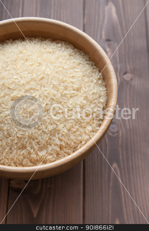 Rice stock photo, Bowl of white rice on wood table by Giordano Aita