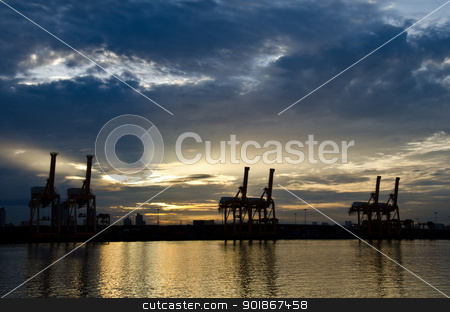 Crane bridge for container cargo. stock photo, Container Cargo freight ship with working crane bridge in shipyard at sunrise  for Logistic Import Export background by chatchai