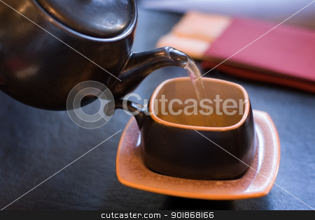 Pouring green tea. stock photo, Pouring green tea, shallow depth of field. by Piotr Skubisz