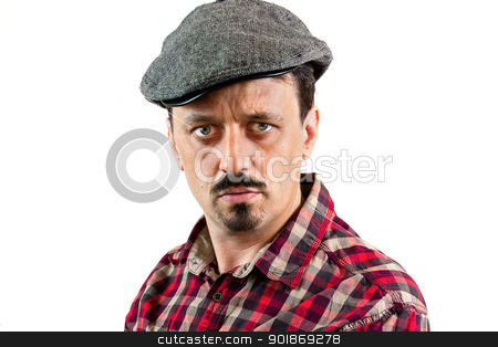 Serious man with a cap stock photo, Portrait in Profile of young man wearing a cap, isolated on white background by tristanbm