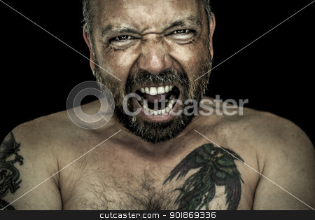 angry man with beard stock photo, An image of an angry man with a beard by Markus Gann