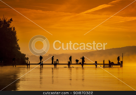jetty early sport stock photo, An old jetty with peolpe doing early sport by Markus Gann