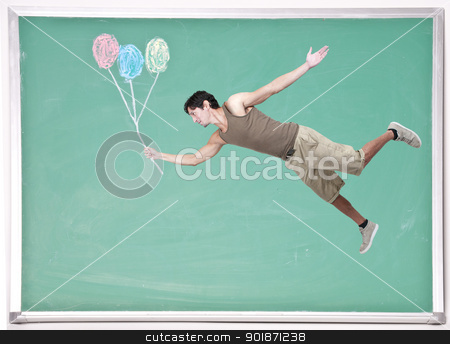 Man Floating with Chalk Balloons stock photo, Handsome young man floating with balloons on a chalkboard by Robert Byron