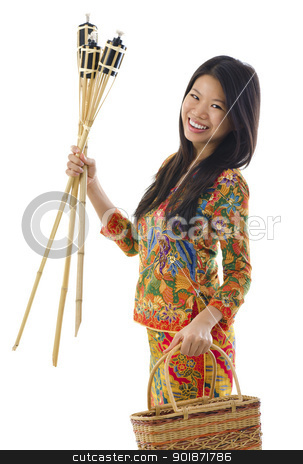 Happy Malay woman stock photo, Happy young Malay woman ready to celebrate Hari Raya Aidilfitri / Eid ul-Fitr by szefei