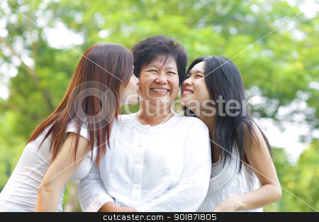 Kissing senior mother stock photo, Young Asian daughter kissing their senior mother, outdoor park by szefei