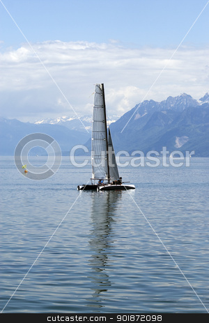 Catamaran on lake stock photo, Catamaran sailing on Lake Geneva in Switzerland. by Abdul Sami Haqqani