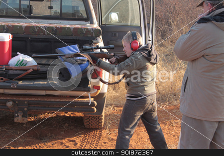 Young Boy Learning to Hunt stock photo, Young Boy Learning to Hunt with Large Caliber Rifle by Snap2Art