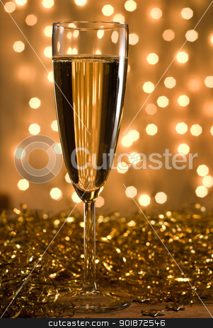 Golden champagne. stock photo, Champagne flute among golden ribbons, defocused lights background - selective focus on the glass. by Piotr Skubisz