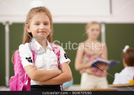 Little girl at school class stock photo, Little blonde girl studying at school class by Sergey Nivens
