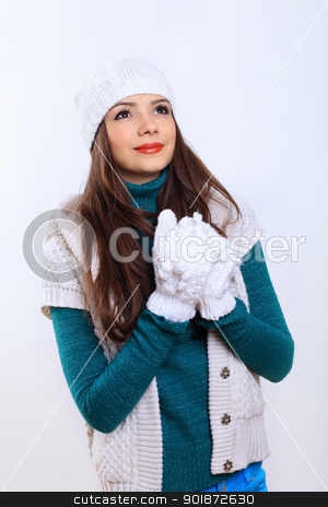 Young woman wearing winter hat and warm scarf stock photo, Young pretty woman in warm winter hat and scarf by Sergey Nivens