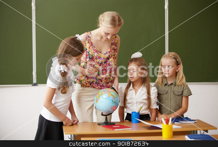 Teacher at school stock photo, Young female teacher working with children at school by Sergey Nivens