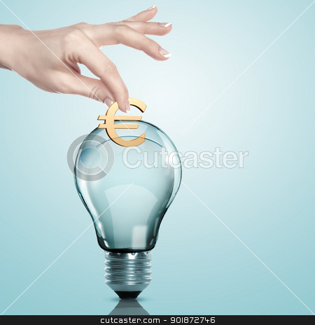 Money inside an electric light bulb stock photo, Hand and money inside an electric light bulb by Sergey Nivens