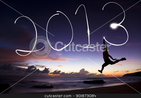 young man jumping and drawing 2013 by flashlight stock photo, young man jumping and drawing 2013 by flashlight by tomwang