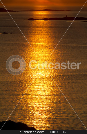 Gold Water stock photo, Deep golden reflection across the water by 35millimetre