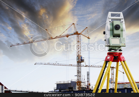 surveying instrument and construction industry stock photo, total-station, surveying instrument with large building industry in background by lagereek