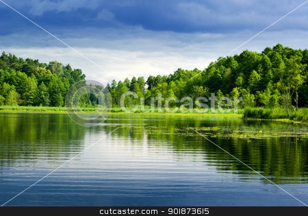 Lake and forest. stock photo, Beautiful lake view - bright interval between rain. Mazury, Poland. by Piotr Skubisz