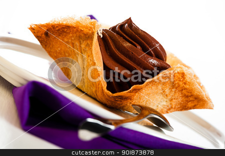 Mousse au chocolat stock photo, Mousse au chocolat in a tuile basket on white wooden table by p.studio66