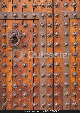 Old medieval wooden door stock photo, Closeup of old medieval wooden door, gothic style. by Kristoffer Pettersson