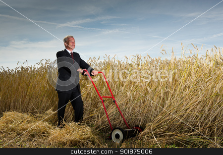 Businessman with a vision stock photo, Seniot executive businessman pausing during the challenge of harvesting a field of ripe wheat with a hand lawnmower as he visualises the rewards to be gained at the completion of his task by Instudio 68