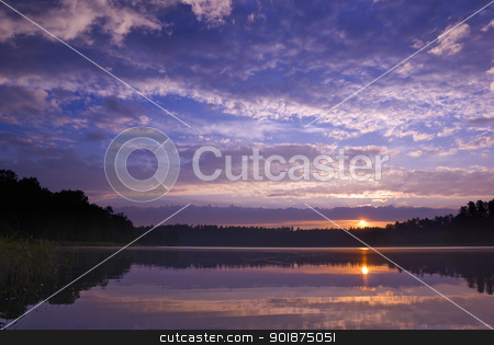 Sunrise. stock photo, Colorful sunrise over the lake. Mazury, Poland. by Piotr Skubisz