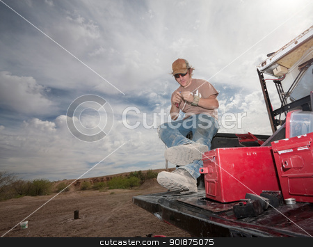 Special Effects Man Working stock photo, Movie special effects specialist working with pyrotechnics on truck by Scott Griessel