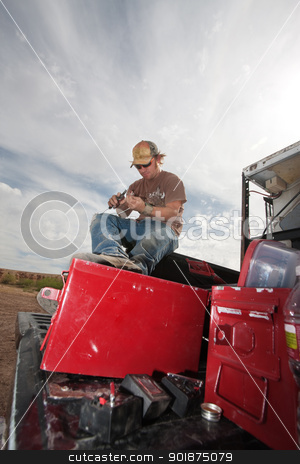 Special Effects Crew Member Preparing Explosives stock photo, Movie EFX expert on truck with pliers and gun powder by Scott Griessel