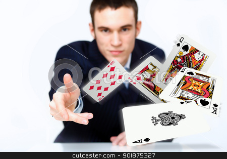 Young man showing poker cards stock photo, Portrait of a young man showing poker cards by Sergey Nivens