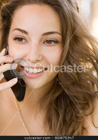 Brunette beauty on mobile phone. stock photo, Portrait of a brunette beauty enjoying conversation on her mobile phone. by exvivo