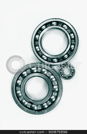 ball bearings and pinions stock photo, ball bearings and pinions set against a light background by lagereek