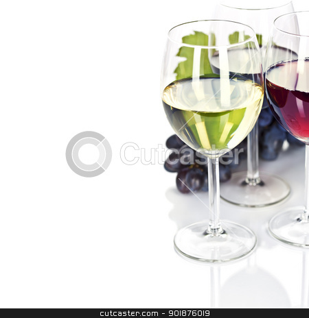 Wine stock photo, Glasses of white, red and rose wine and grapes over white by klenova