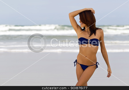 Bikini Model On Beach stock photo, A young female model enjoying a day at the beach by Walter Arce