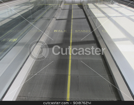 Moving Walkway stock photo, A moving walkway at a modern airport by Walter Arce