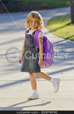 Little Girl Ready For School stock photo, A young little girl preparing to walk to school by Walter Arce