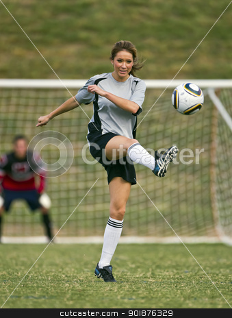 Female Soccer Player stock photo, Female soccer player working out on a soccer field by Walter Arce