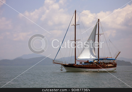 Yacht in Phang Nga Bay stock photo, Yacht in Phang Nga Bay by Kevin Hellon
