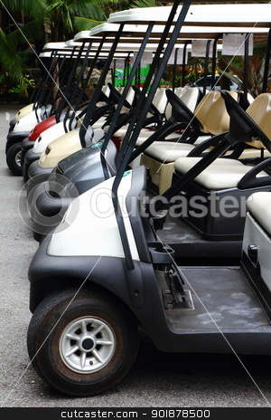 Golf carts  stock photo, Golf carts on a parking lot  by kongsky