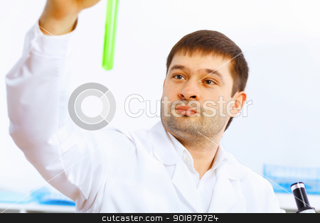 Young male scientist working in laboratory stock photo, Young male scientist working with liquids in laboratory by Sergey Nivens