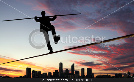 Balancing businessman and cityscape stock photo, Business man balancing high over a cityscape  by Sergey Nivens