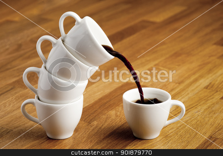 Pouring coffee. stock photo, Pouring coffee. by Piotr Skubisz