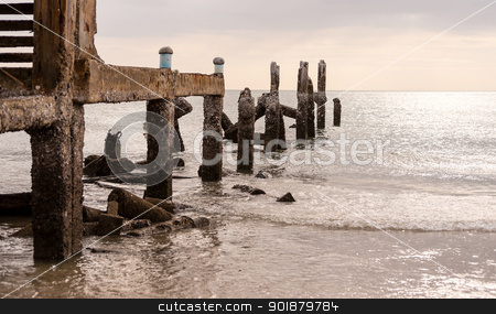 Old jetty in sea in overcast sky day  stock photo, Old jetty in sea in overcast sky day evenning time by moggara12