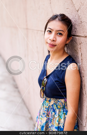 Portrait woman asian girl against the wall stock photo, Portrait woman asian girl against the wall with face smile by moggara12