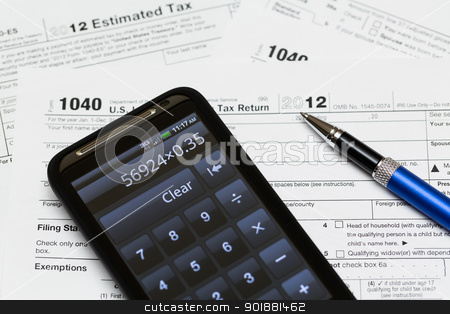 USA tax form 1040 for year 2012 stock photo, Tax form 1040 for tax year 2012 for US individual tax return with smartphone calculator by Steven Heap