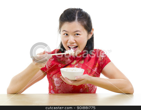 Asian woman eating rice stock photo, Asian woman eating rice with chopsticks over white background by szefei
