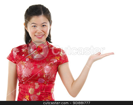 Empty hand stock photo, Chinese Asian woman in Traditional Cheongsam showing empty hand over white background. by szefei