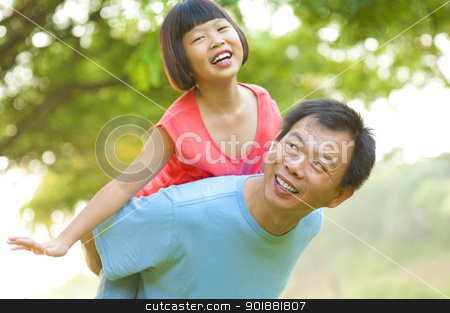 Piggyback stock photo, A father and child on a nice summer day. by szefei