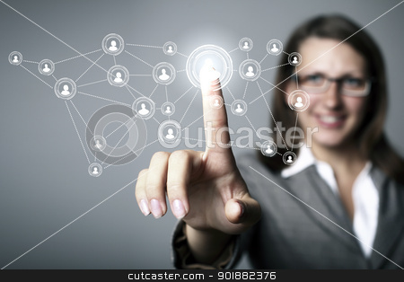 Businesswoman pressing social media icon stock photo, Businesswoman in suit pressing social media icon by Sergey Nivens