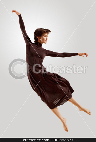 Girl in dark dress dancing stock photo, Girl dancing in a dark dress with a gray background. isolate by Sergey Nivens